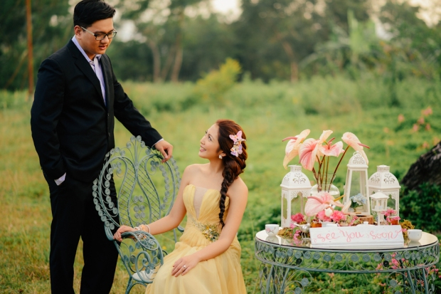 cuckoo cloud concepts david and jaja enchanted engagement session wooden swing lush greens pink flowers-12