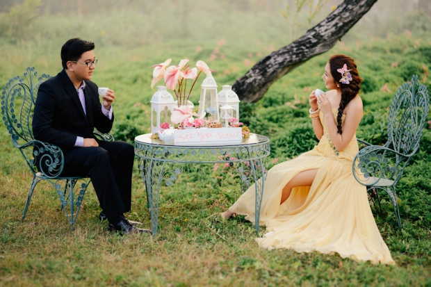 cuckoo cloud concepts david and jaja enchanted engagement session wooden swing lush greens pink flowers-15