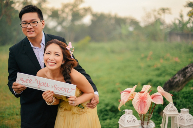 cuckoo cloud concepts david and jaja enchanted engagement session wooden swing lush greens pink flowers-19