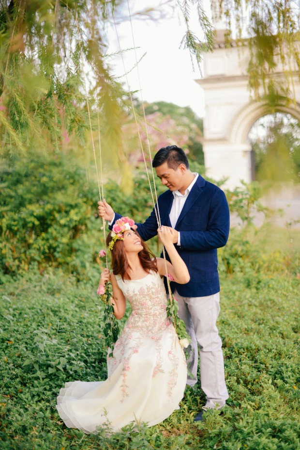 cuckoo cloud concepts david and jaja enchanted engagement session wooden swing lush greens pink flowers-20
