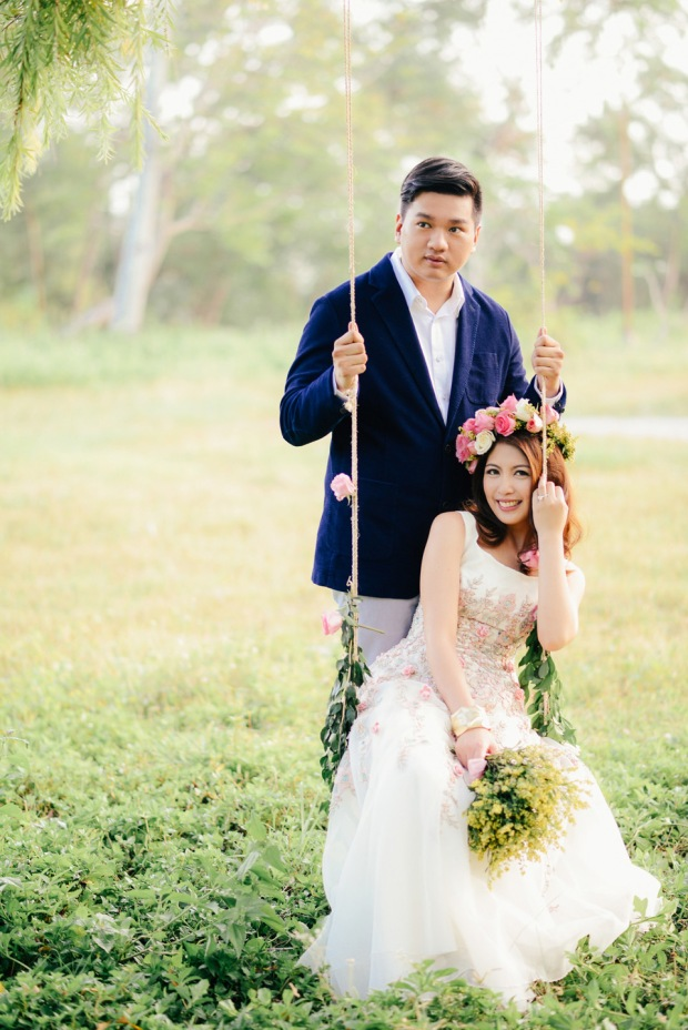 cuckoo cloud concepts david and jaja enchanted engagement session wooden swing lush greens pink flowers-22
