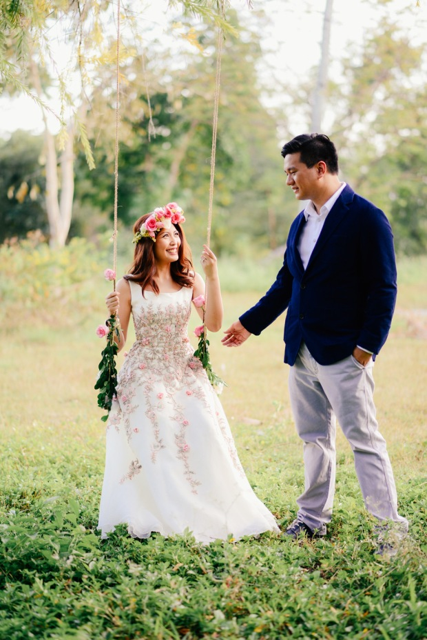 cuckoo cloud concepts david and jaja enchanted engagement session wooden swing lush greens pink flowers-45