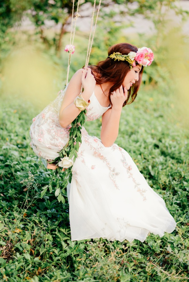 cuckoo cloud concepts david and jaja enchanted engagement session wooden swing lush greens pink flowers-46