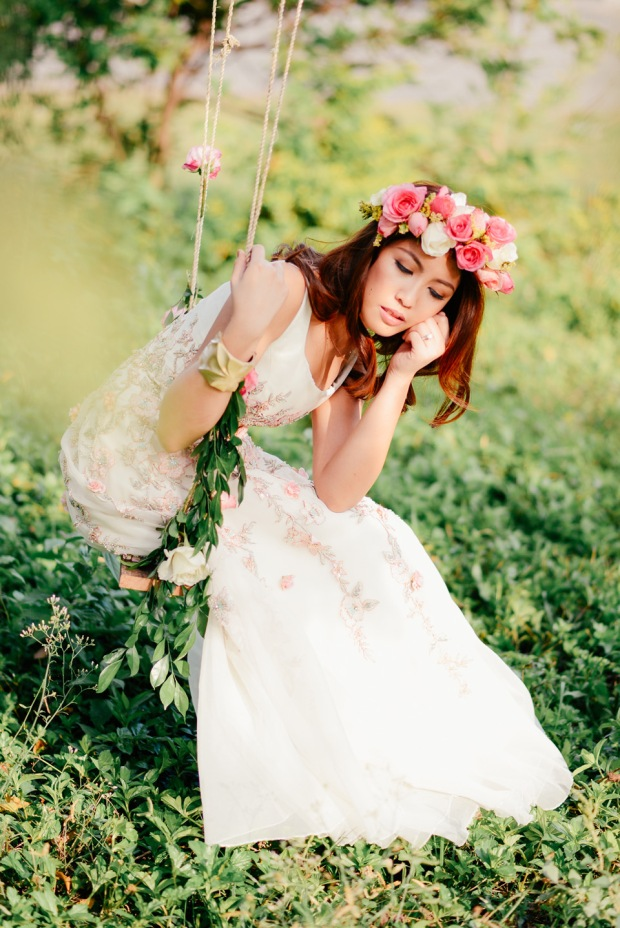 cuckoo cloud concepts david and jaja enchanted engagement session wooden swing lush greens pink flowers-47