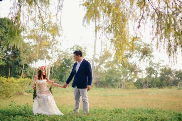 cuckoo cloud concepts david and jaja enchanted engagement session wooden swing lush greens pink flowers-6
