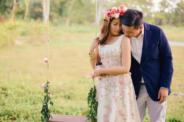 cuckoo cloud concepts david and jaja enchanted engagement session wooden swing lush greens pink flowers-7