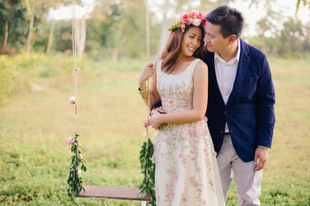 cuckoo cloud concepts david and jaja enchanted engagement session wooden swing lush greens pink flowers-8