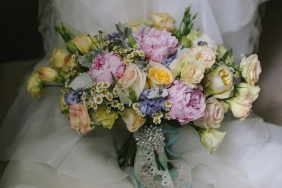 A mix of pastels in pink, peach and lavender for Vanessa's carnival-inspired wedding